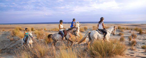 A cheval sur la plage diaporama